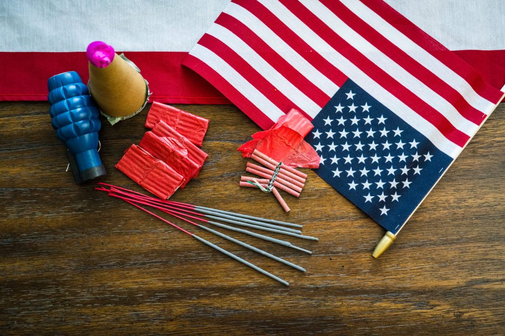 fireworks lay down shot with american flag