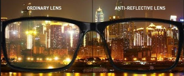 glasses with city scene in the background showing ordinary lens view and anti-reflective lens view