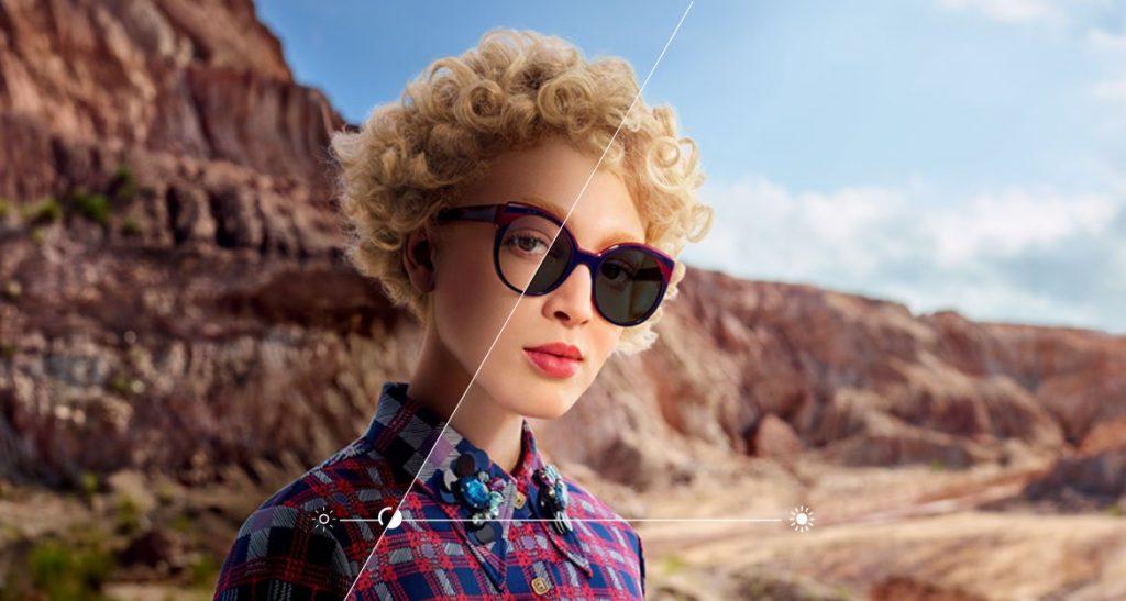 Model wearing transitions lenses in desert