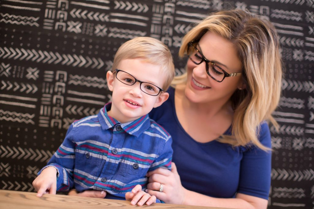 mother and child with glasses smiling