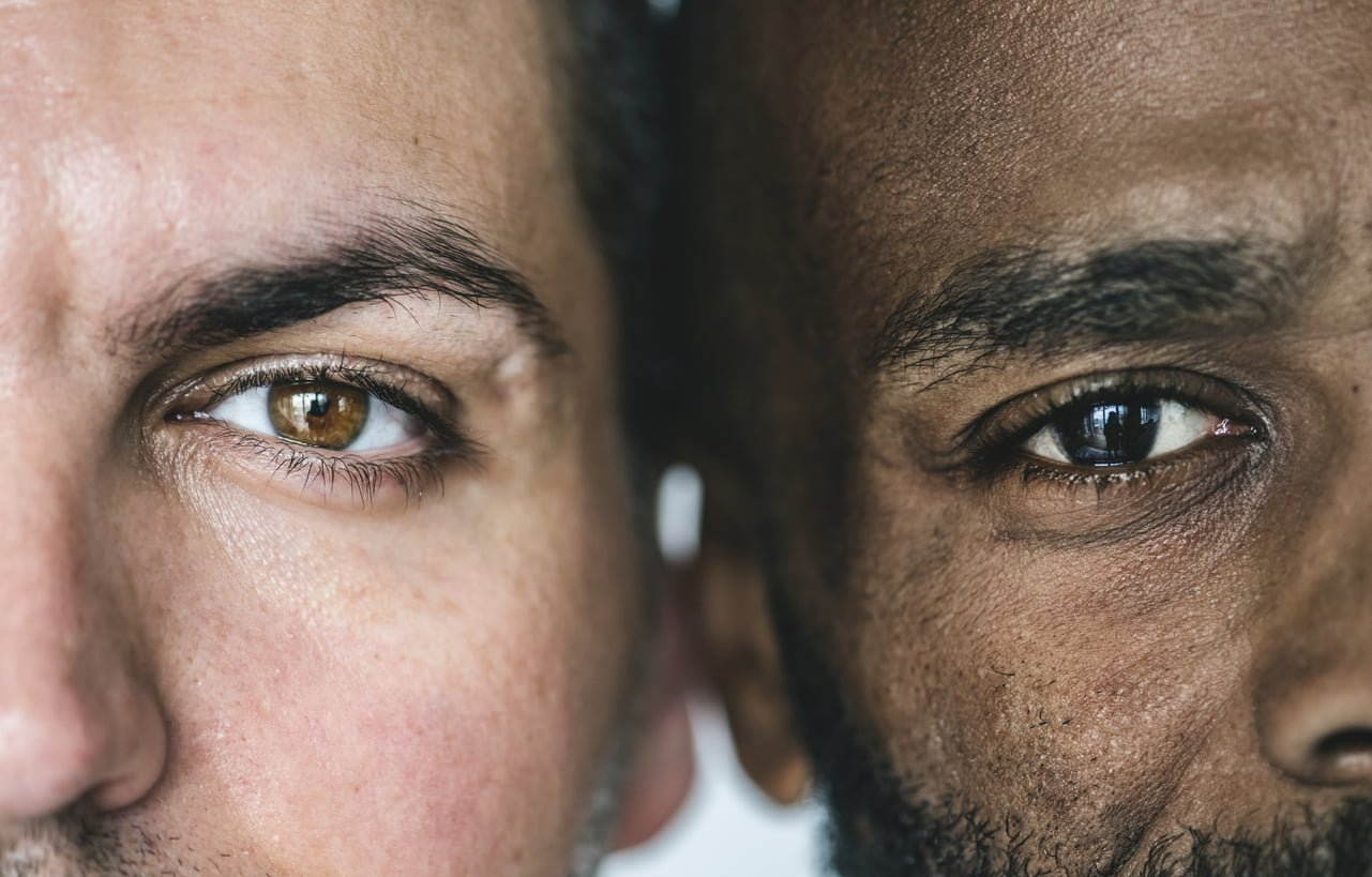 Two different men's eyes closeup