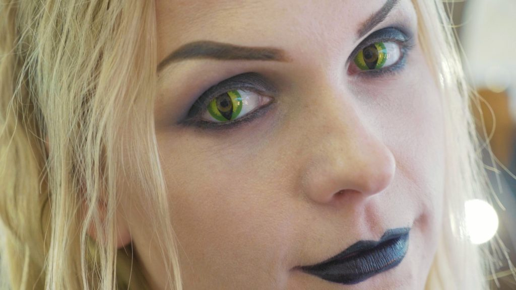 woman wearing colored contact lenses that are cat eye shaped