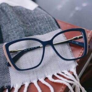 glasses on black and white scarf